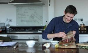 a man preparing a lamb joint