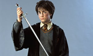 HARRY POTTER holding wand