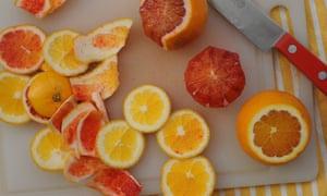 prepared orange segments of a chopping board