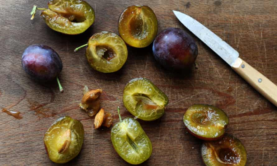 plums on a chopping board