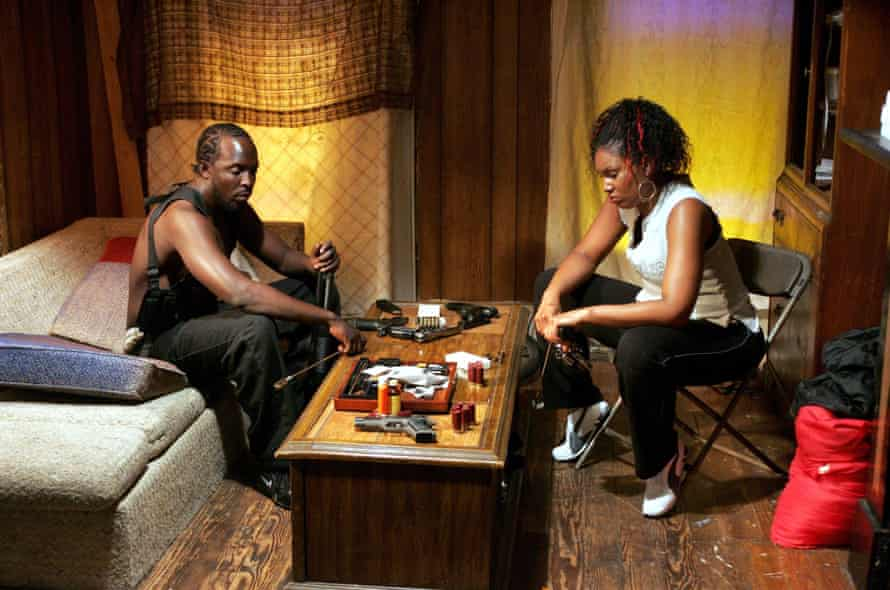 Michael K Williams as the gay 'Robin Hood' dealer Omar in The Wire, with Kelli R Brown.