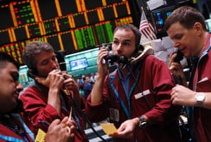 Traders work in the crude oil and natural gas options pit on the floor of the New York Mercantile Exchange.