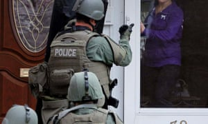 A Swat team conducts searches in Boston.