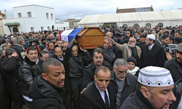 People carry the coffin of murdered police officer Ahmed Merabet after a funeral service at the Bobi