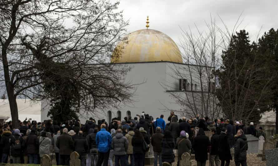 The funeral of Ahmed Merabet at a Muslim cemetery in Bobigny.