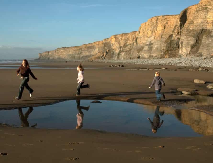 Children on a beach at Traeth Mawr in South Wales