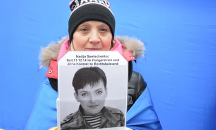 A protester calls for the release Ukrainian pilot Nadia Savchenko in front of the Russian Embassy in Berlin last week. Savchenko was captured by pro-Russian insurgents in eastern Ukraine in June 2014, and is being held in Russia.