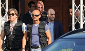 Roberto Saviano with his armed guards