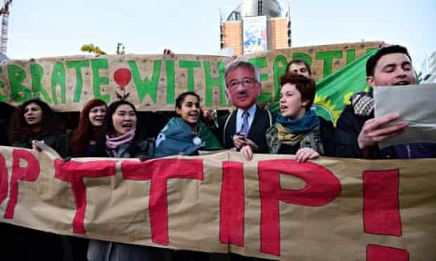 Activisits stage a protest against the TTIP, in front of the European commission in Brussels