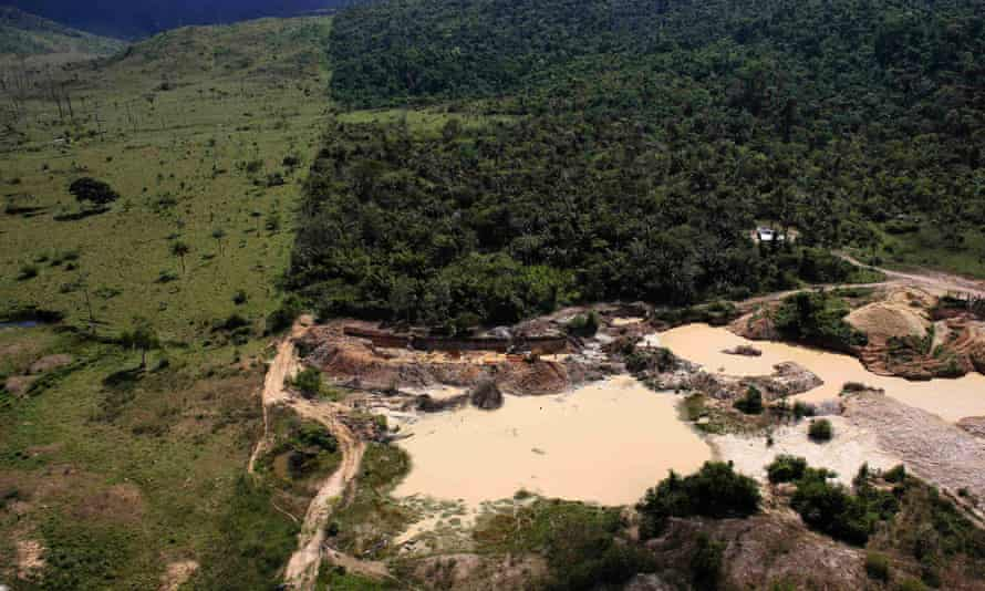 An illegal gold mine, located on an area of deforested Amazon rainforest, is seen near the city of Castelo dos Sonhos, Para State, Brazil