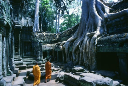Monks in Angkor's Ta Prohm temple.