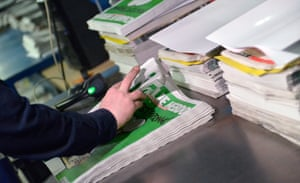 A worker prepares the new edition of Charlie Hebdo for delivery in a press distribution centre in Marne-la-Vallee, France
