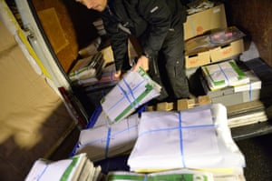 The new edition of Charlie Hebdo is prepared for delivery at a press distribution centre