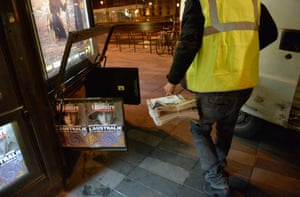 A van brings the first delivery of the new edition to a kisok in Place de la Republique in Paris