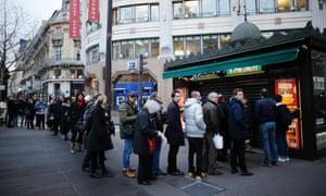 People queue to get a copy in Paris