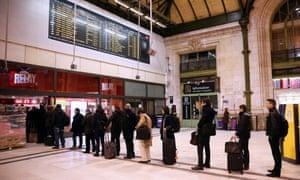 Commuters queue at Gare de Lyon train station in Paris