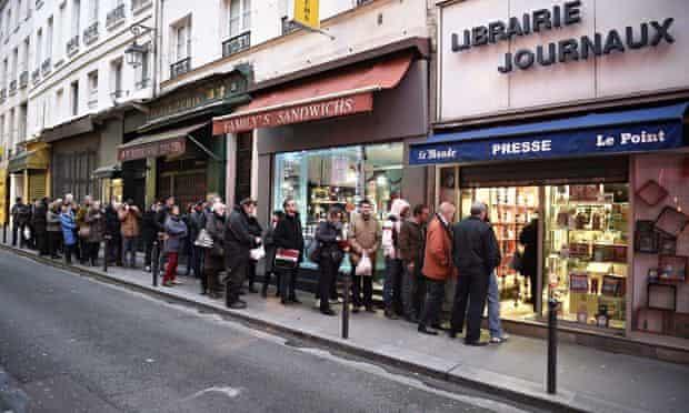 Queue outside newsagent in Paris