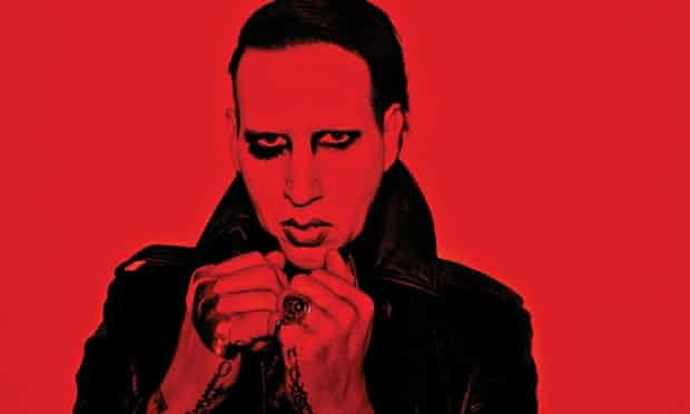 Marilyn Manson with rings, tattoos and heavy make up