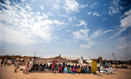 Sudanese women and children rest at the Kalma refugee camp for internally displaced people, south of the Darfur town of Nyala, Sudan, in March 2014.