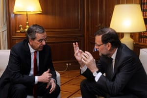 Greek Prime Minister Antonis Samaras (L) talks his Spanish counterpart Mariano Rajoy Brey (R) during their meeting in Athens, on 14 January 2015.