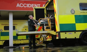 A patient is taken from an ambulance outside the Accident and Emergency ward at St Thomas' Hospital on 6 January, 2015.