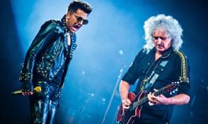 Adam Lambert with Brian May in concert in Michigan last year