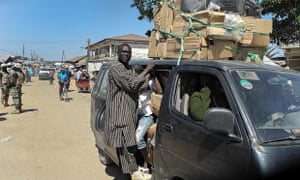 Nigerians cram into a bus to flee a town in north-east Nigeria following Boko Haram attack on Baga