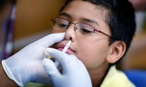 boy geting flu vaccination