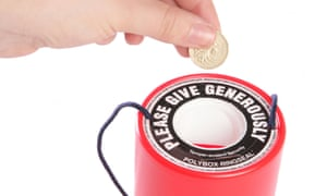 Pound in charity tin