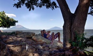 A fisherman rests by the side of Lake Nicaragua.