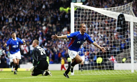 Peter Lovenkrands scores against Celtic in the 2002 Cup Final.