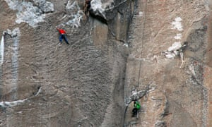 Tommy Caldwell, in red, climbs pitch 19 while cameraman Brett Lowell records at lower right and another unidentified cameraman shoots from above