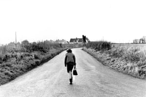 This photograph shows pupil, Sherry Wheeler on her way home from school, Essex, December 1985. This photograph was taken 10 months into the teacher's dispute, which disrupted life at most of Britain's 34,ooo state schools. The photographer, Jane Bown had been commissioned to cover Ongar Comprehensive school in Essex for an article on the strike titled School's Out.