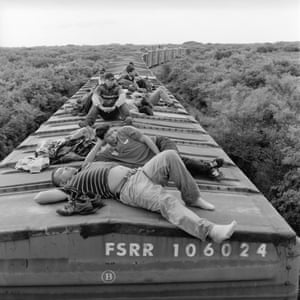 Undocumented Central American migrants ride a northbound freight train