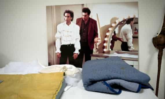 Seinfeld checks out his puffy shirt.