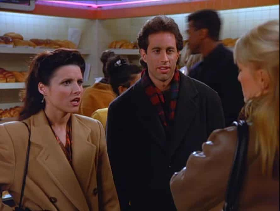 Elaine in a camel trenchcoat.