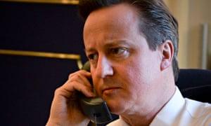 David Cameron talking on the telephone to US president, Barack Obama