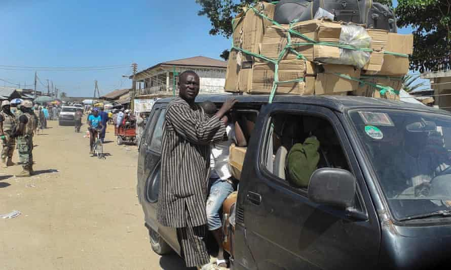 Nigerians cram into a bus fleeing the town of Mubi following the attacks.