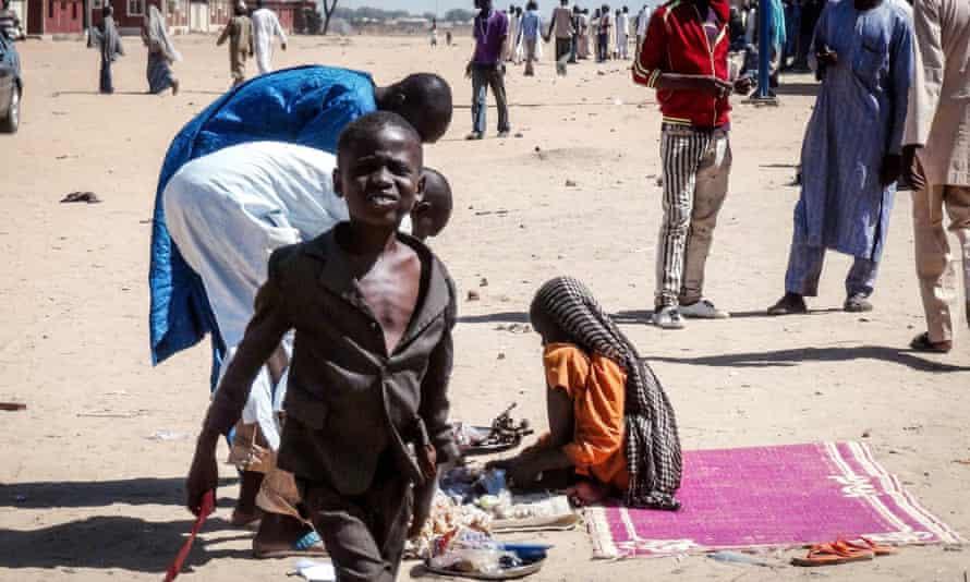 People take refuge in Teachers Village in Maiduguri province.