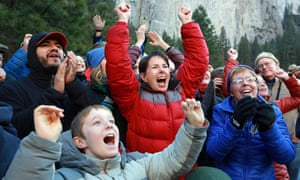 Gaelena Jorgenson, of Santa Rosa, center in red, raises her arms as her son Kevin completes a free climb of El Capitan