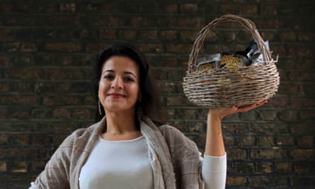Manal Ramadan holding a basket of zaytoun ollive oil