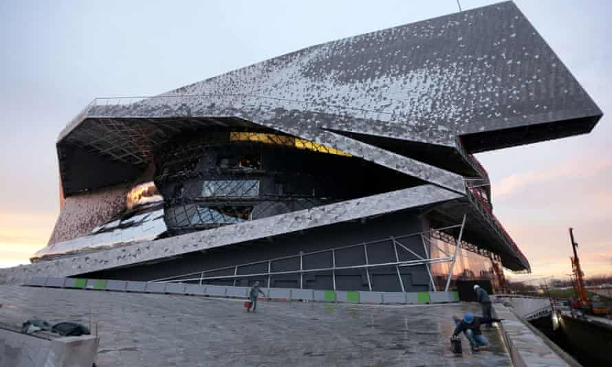 Labourers work at the new Philharmonie de Paris ahead of its opening on 14 January.