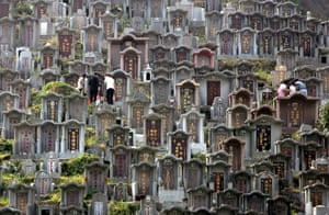 Worshippers clean the graves of their ancestors at a cemetery during Chung Yeung festival in Hong Kong. During the festival, many people visit the graves of family members to perform cleansing rites and pay their respects