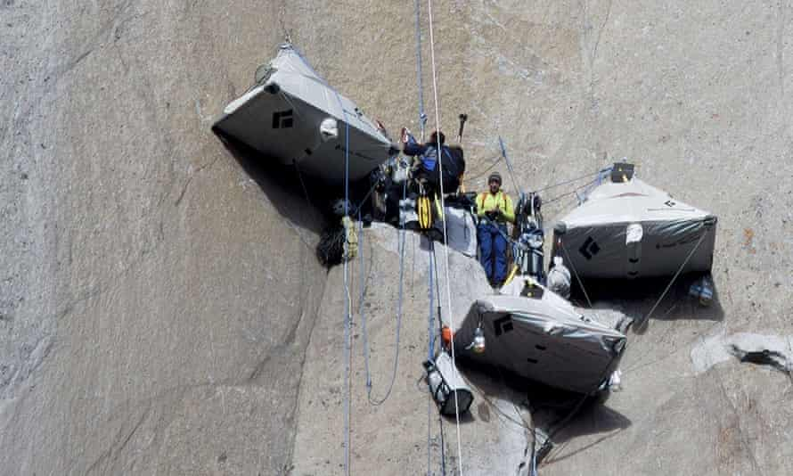 Tommy Caldwell, centre, with a photographer at a base camp during the Dawn Wall climb.