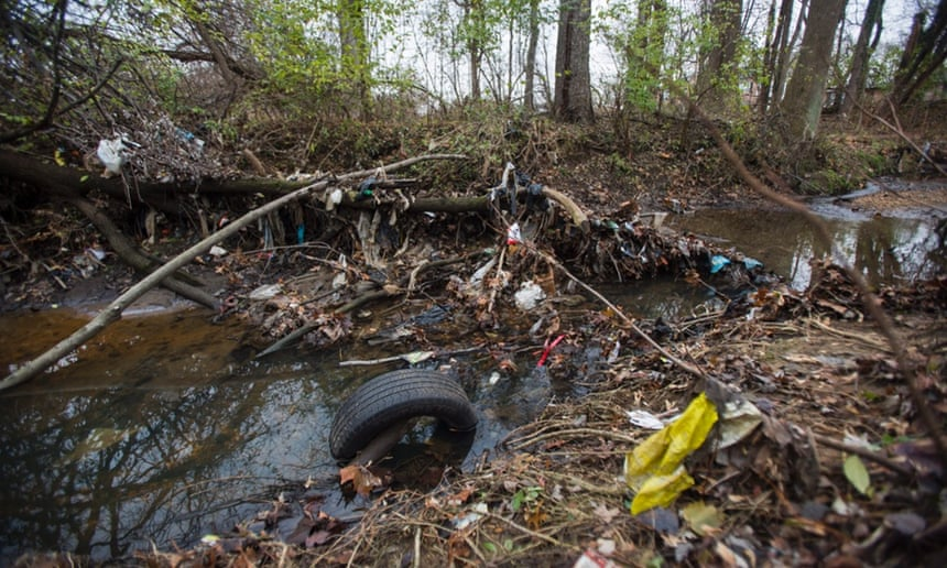 Trash accumulates on Nash Run, a creek that empties into the Anacostia River, in Washington DC, US, 4 December 2014. Environmental groups routinely list the Anacostia as one of the most polluted waterways in America.