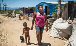 'I like living here' ... Mara Lucia Feitosa with one of her 12 children, in Esqueleto. Photograph: Lianne Milton
