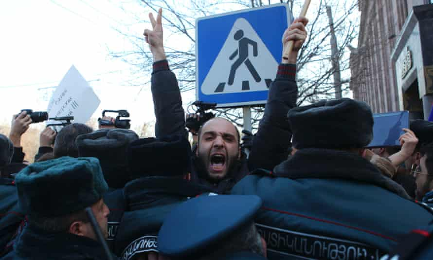 Thousands of Armenians rallied outside the Russian embassy in Yerevan and near the Russian military base in the town of Gyumri today, demanding the handover of a Russian soldier suspected of killing a family.