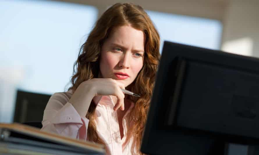 woman skeptical computer