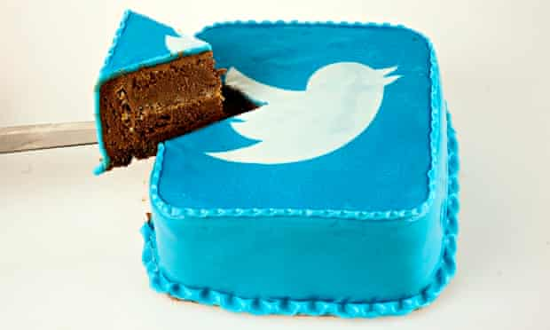 A cake decorated with the Twitter logo