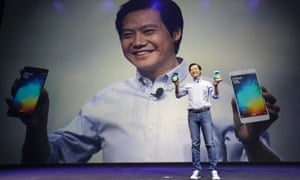 Lei Jun, founder and chief executive officer of China's mobile company Xiaomi, shows Mi Notes at its launch in Beijing January 15, 2015. Xiaomi Inc is the world's third-biggest smartphone maker.